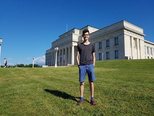 Max Nichol standing outside the Auckland War Memorial Museum